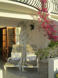 An ambitious bright pink bougainvillea creates dappled afternoon shade on the terrace as it climbs to the bedroom...