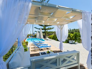 Comfortable outdoor seating area by the pool