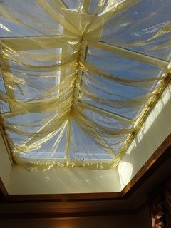Roof light so that you may have curtains drawn but natural light.