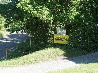 Sign at base of driveway.