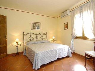 Appartamenti in casa di campagna tra viti e olivi.