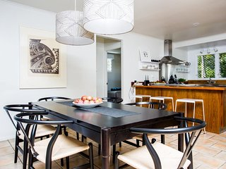 Indoor dining and kitchen breakfast bar