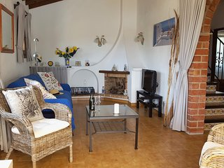The charming living room has German or UK satellite TV  and DVD player