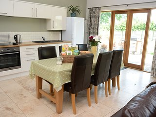 DIning Area with patio doors to rear garden and bbq area