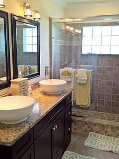 Master Bathroom with walk-in shower and double sinks