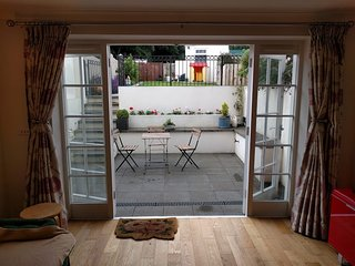 Sheltered patio just off living room