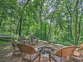 You'll love spending time outside in this home's beautiful backyard, featuring a hammock and new fire pit.