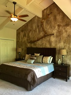 Master bedroom with new comforter, pillows, bedding linens
