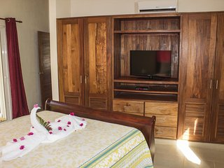 This villa Tranquila with two bedrooms will be felt like home. Each bedroom has a safe and a cable TV! WI-FI included. Furnished terrace with the barbecue and a private pool that lets you see the view of a green jungle.(643)