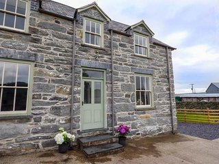 "WAEDOG BACH, romantic cottage, attached to owner""s farmhouse, on a working"