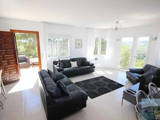 large, light, comfortably furnished lounge with exceptional views over valley to hills beyond.