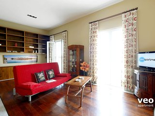 Living area with 2 windows facing the river. Double sofa-bed, coffee table and TV.