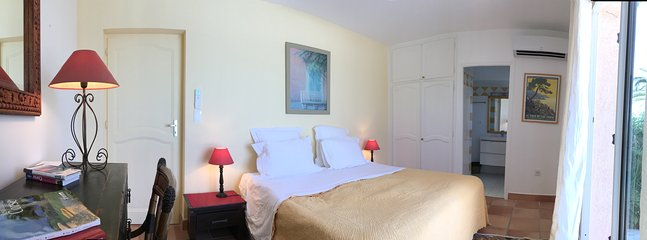 Yellow double bedroom with ensuite bathroom and sea and mountain views
