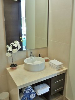 The large master en-suite bathroom comes complete with fluffy towels and more