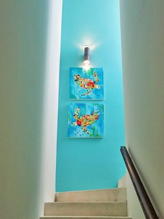 Custom artwork in the stairwell draws you up to your large private terrace