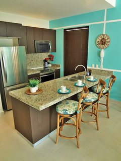 Complete kitchen and adjacent laundry room have all you need, plus fresh drinking water