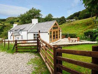 PEN Y BONT, detached character cottage, WiFi, woodburning stove, pet-friendly, L