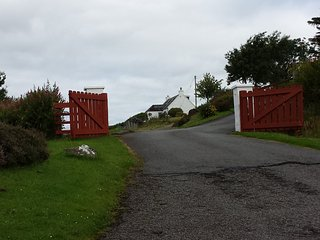 Entrance. Cottage can be seen at the top of the slip road.