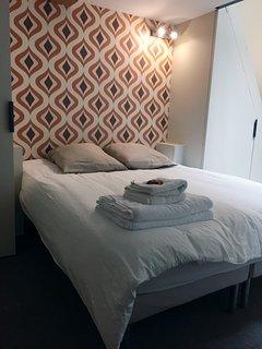 Chambre 2 lit double + lit simple sur mezzanine
