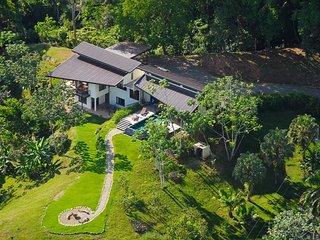 to Lattice House, surrounded by jungle, facing the spectacular coastline below.
