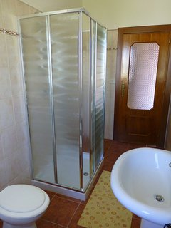 Upstairs bathroom with extended size shower cubicle.