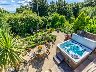 The outdoor hot tub is a full-sensory experience: 30 Hydrotherapy jets and Bio-Magnetic Therapy.