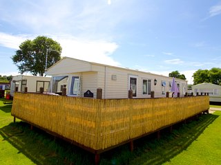 Ref 20034 8 berth caravan for hire with large decking at Broadland Sands.