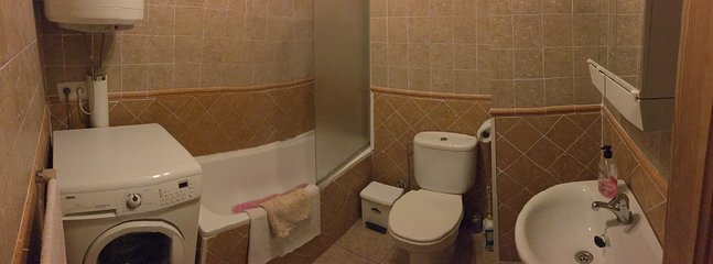 Bathroom (with bath/shower and Zanussi washing machine)