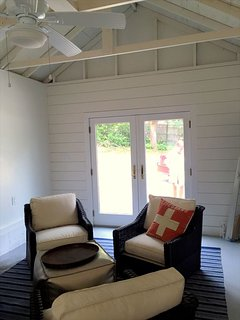 NEWLY REMODELED garage for additional living space off of screened porch!