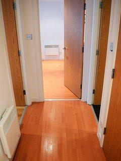 Hallway area including storage cupboard.