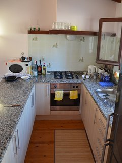 Kitchen with microwave, large fridge freezer, oven and hob,,kettle.
