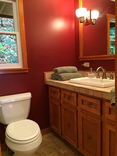 Middle level bathroom, with tub and shower.