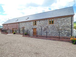 THE HAYLOFT, barn conversion, three bedrooms, one ground floor, private garden