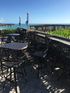 CLOSED: Havana Jacks seating area with public fishing pier! (new owners- use to be Cabana Breezes)!