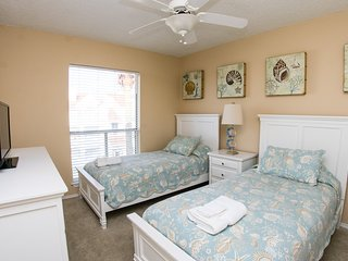Sea shell-themed second bedroom