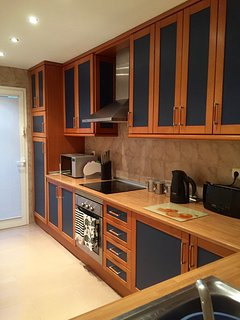 Fully equipped kitchen, with fridge/freezer, dishwasher, microwave, cooker. Door to utility area.