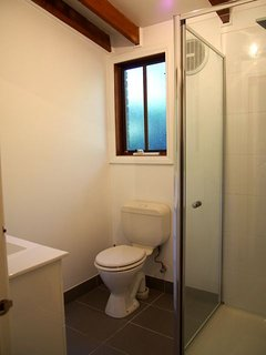 Family bathroom downstairs with shower, WC & vanity.