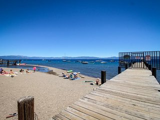 A spacious deck & foosball table, walk to the beach & Homewood!