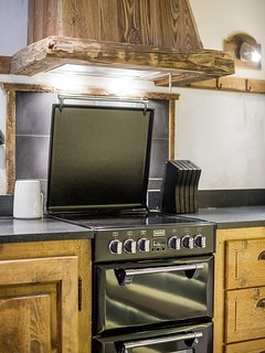 The hob and dual oven are in a classic range master style but are thoroughly modern.