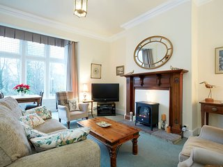 Sitting room with tall ceilings, period features, fireplace, TV, DVD , games, books.