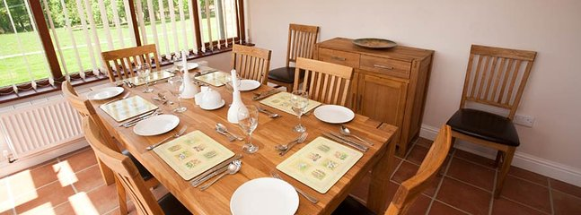 A dining area is provided in the conservatory with views of the beautiful countryside on all sides