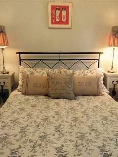 Comfortable double bed in separate bedroom.