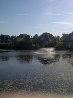 Beautiful landscaped gardens with feature lake and fountain.