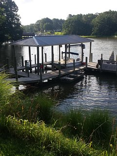 Dock with plenty of boat space to dock your boat and 5ft of water.