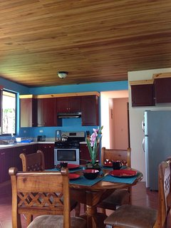 This is the full-equipped kitchen to the right of the open sitting area.