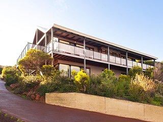 Wraparound decks with glass balustrades.