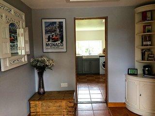 Entrance hall through to kitchen.