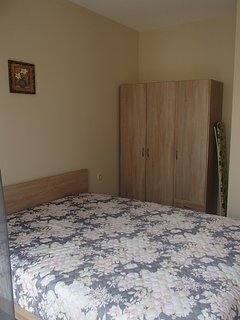 Bedroom with double bed and air conditioner