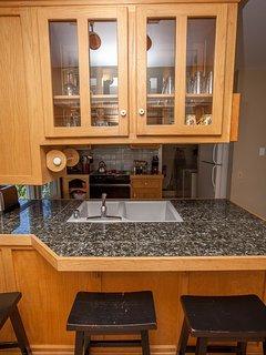 Upper - Open kitchen area w bar