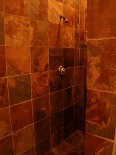 Walk in tile shower in each suite